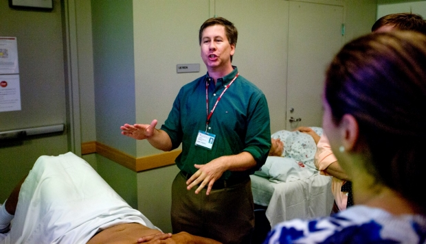 Professor of Clinical Medicine, Dr. Eric Strong teaching the physical exam to colleagues