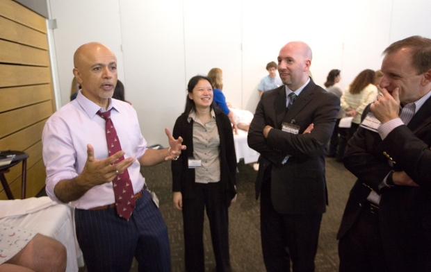 Abraham Verghese discusses bedside medicine with colleagues