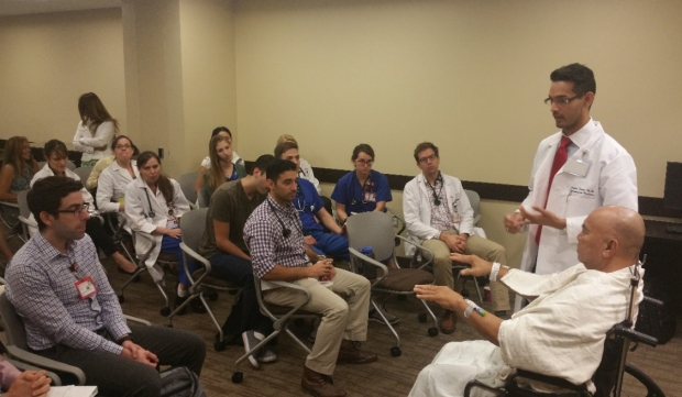 Dr. Junaid Zaiman demonstrates bedside exam technique